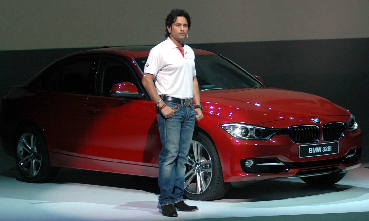 indian cricketer sachin tendulkar posing with bmw 3 series