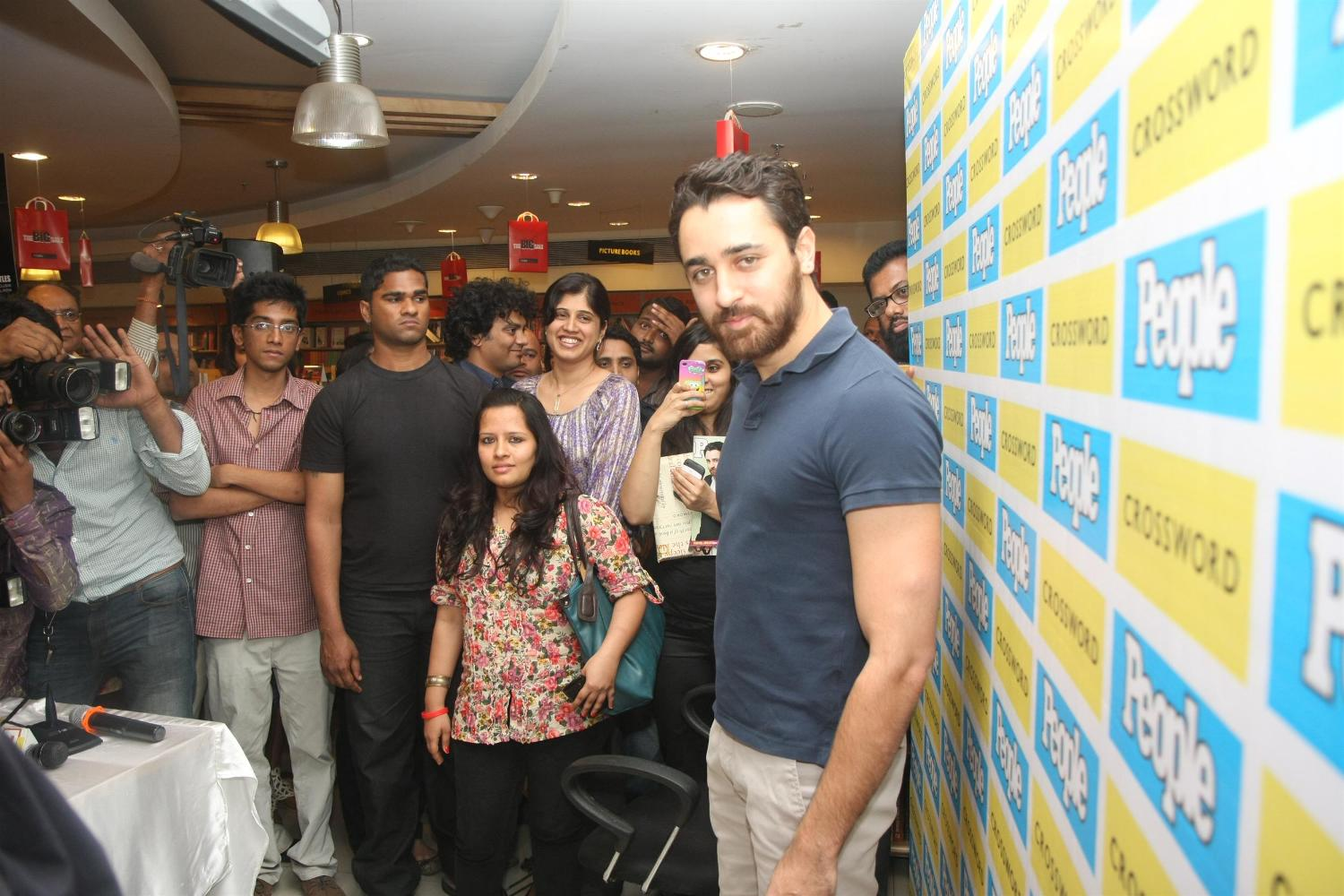 Khan posing for photographers at the launch of latest issue of People