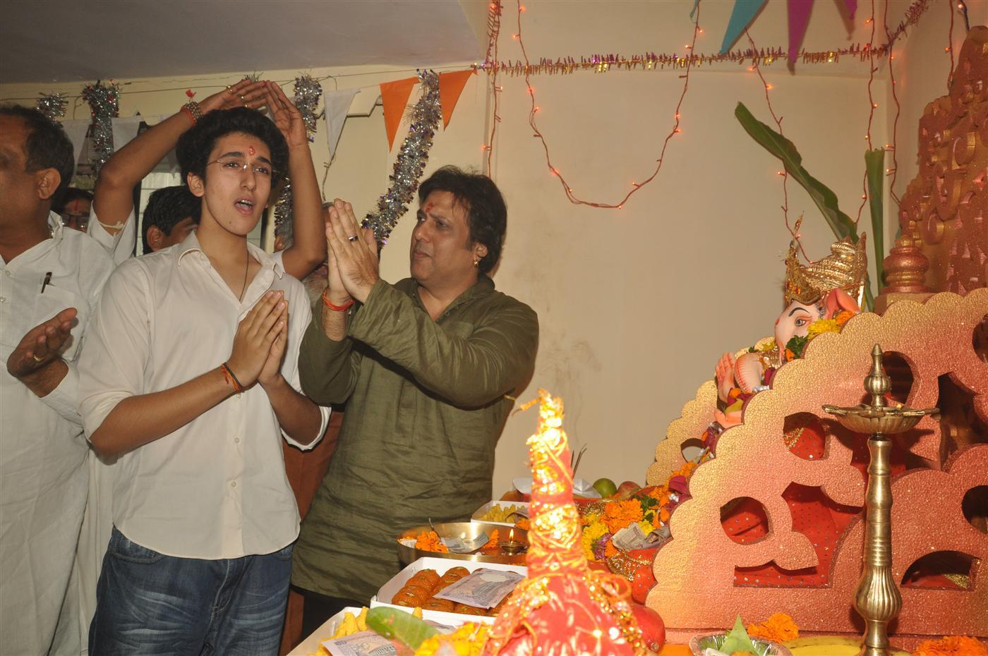 Decoration For Puja At Home Govinda With His Son Arjun Singh Performing Aarti At His