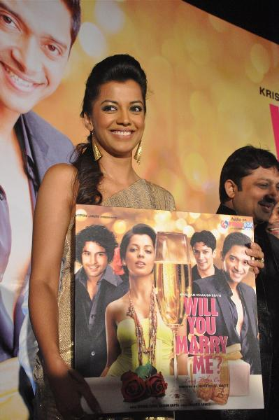 Mugdha Godse posing with audio cds of film Will You Marry Me at its music launch at Hotel JW Marriott in Mumbai  1