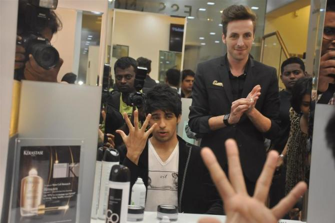Siddharth malhotra getting his hair done at the launch of for Dessange hair salon